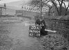 SD980420A, Man marking Ordnance Survey minor control revision point with an arrow in 1950s