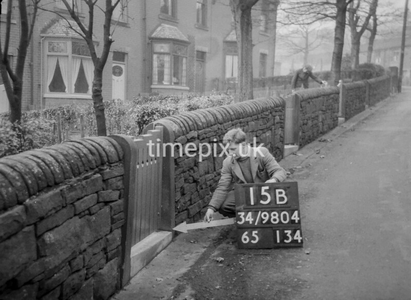 SD980415B, Man marking Ordnance Survey minor control revision point with an arrow in 1950s