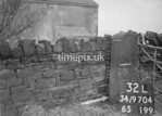 SD970432L, Man marking Ordnance Survey minor control revision point with an arrow in 1950s