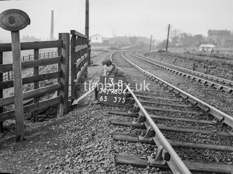 SD960413B, Man marking Ordnance Survey minor control revision point with an arrow in 1950s