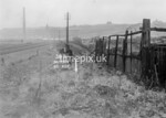 SD950438A, Man marking Ordnance Survey minor control revision point with an arrow in 1950s