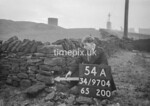 SD970454A, Man marking Ordnance Survey minor control revision point with an arrow in 1950s