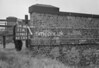 SD980311A, Man marking Ordnance Survey minor control revision point with an arrow in 1950s