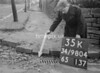 SD980435K, Man marking Ordnance Survey minor control revision point with an arrow in 1950s