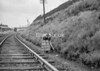 SD970380B, Man marking Ordnance Survey minor control revision point with an arrow in 1950s