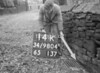SD980414K, Man marking Ordnance Survey minor control revision point with an arrow in 1950s