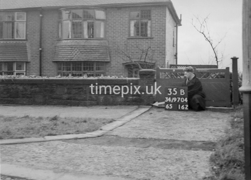 SD970435B, Man marking Ordnance Survey minor control revision point with an arrow in 1950s