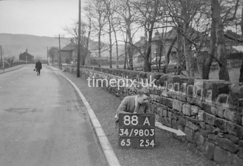 SD980388A, Man marking Ordnance Survey minor control revision point with an arrow in 1950s