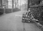 SD980415A, Man marking Ordnance Survey minor control revision point with an arrow in 1950s