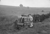 SD980385B, Man marking Ordnance Survey minor control revision point with an arrow in 1950s
