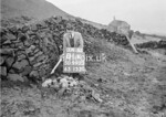 SD990301K, Man marking Ordnance Survey minor control revision point with an arrow in 1950s