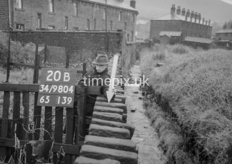SD980420B, Man marking Ordnance Survey minor control revision point with an arrow in 1950s