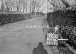 SD970428A, Man marking Ordnance Survey minor control revision point with an arrow in 1950s
