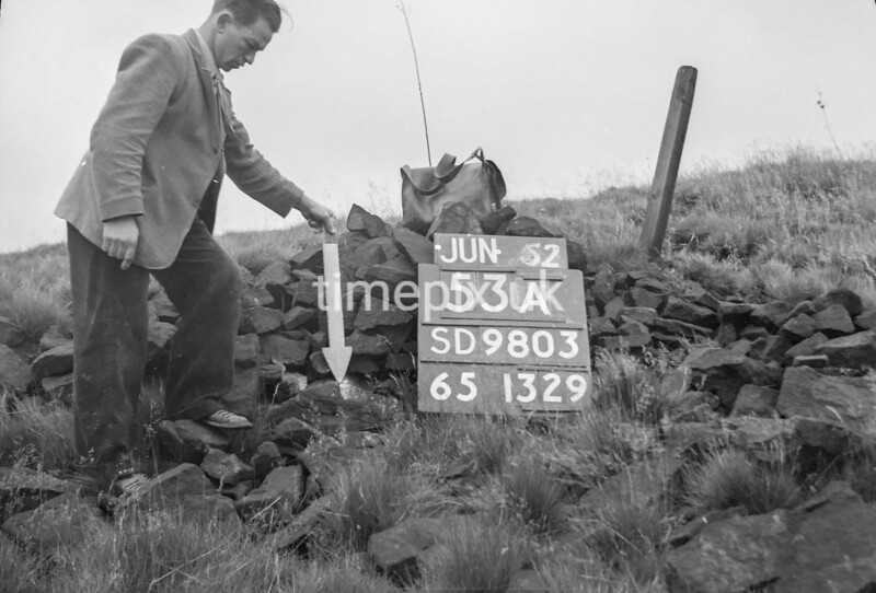 SD980353A3, Man marking Ordnance Survey minor control revision point with an arrow in 1950s