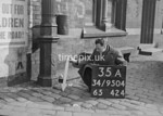 SD950435A, Man marking Ordnance Survey minor control revision point with an arrow in 1950s