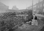 SD970432B, Man marking Ordnance Survey minor control revision point with an arrow in 1950s