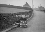 SD970440B, Man marking Ordnance Survey minor control revision point with an arrow in 1950s