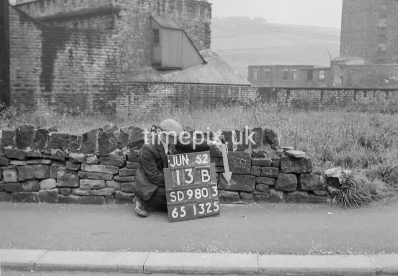 SD980313B, Man marking Ordnance Survey minor control revision point with an arrow in 1950s