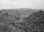 SD950304B, Man marking Ordnance Survey minor control revision point with an arrow in 1950s