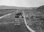 SD950303K, Man marking Ordnance Survey minor control revision point with an arrow in 1950s