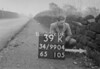 SD990439K, Man marking Ordnance Survey minor control revision point with an arrow in 1950s