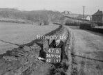 SD970447B, Man marking Ordnance Survey minor control revision point with an arrow in 1950s