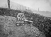 SD980411A, Man marking Ordnance Survey minor control revision point with an arrow in 1950s