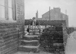 SD970432A, Man marking Ordnance Survey minor control revision point with an arrow in 1950s
