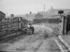 SD960443L, Man marking Ordnance Survey minor control revision point with an arrow in 1950s