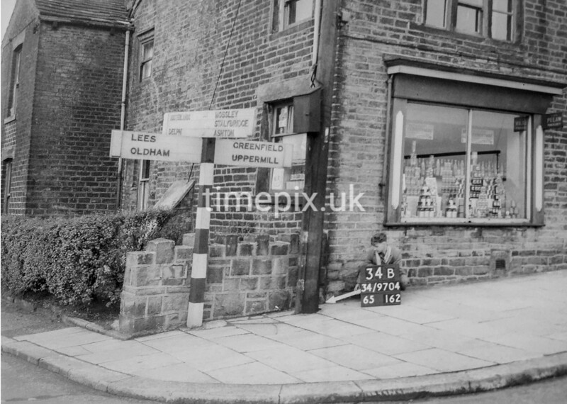 SD970434B, Man marking Ordnance Survey minor control revision point with an arrow in 1950s