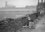 SD970431B, Man marking Ordnance Survey minor control revision point with an arrow in 1950s