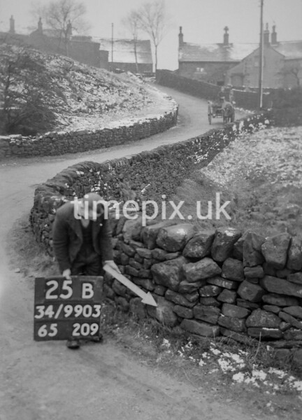 SD990325B, Man marking Ordnance Survey minor control revision point with an arrow in 1950s