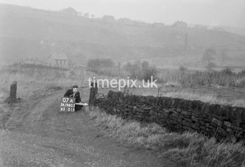 SD980307A, Man marking Ordnance Survey minor control revision point with an arrow in 1950s
