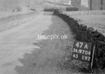 SD970447A, Man marking Ordnance Survey minor control revision point with an arrow in 1950s