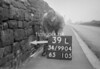 SD990439L, Man marking Ordnance Survey minor control revision point with an arrow in 1950s