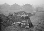 SD970454B, Man marking Ordnance Survey minor control revision point with an arrow in 1950s