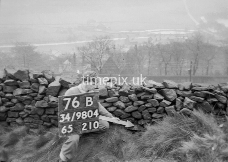 SD980476B, Man marking Ordnance Survey minor control revision point with an arrow in 1950s