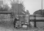 SD970433B, Man marking Ordnance Survey minor control revision point with an arrow in 1950s