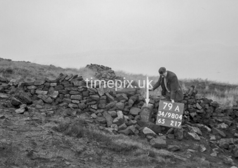 SD980479A, Man marking Ordnance Survey minor control revision point with an arrow in 1950s