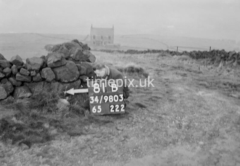 SD980381B, Man marking Ordnance Survey minor control revision point with an arrow in 1950s