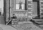 SD950436A, Man marking Ordnance Survey minor control revision point with an arrow in 1950s