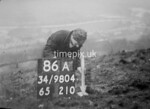 SD980486A, Man marking Ordnance Survey minor control revision point with an arrow in 1950s