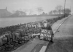 SD970440A, Man marking Ordnance Survey minor control revision point with an arrow in 1950s