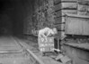 SD970493B, Man marking Ordnance Survey minor control revision point with an arrow in 1950s