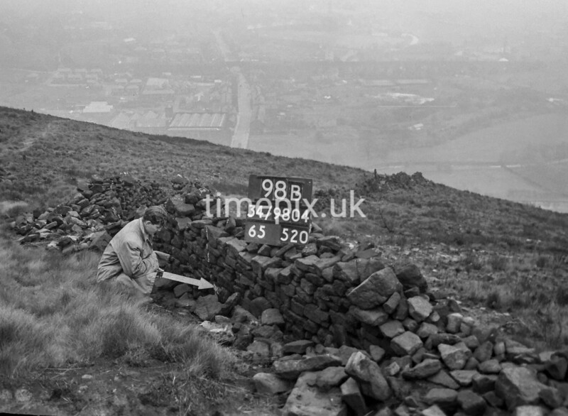 SD980498B, Man marking Ordnance Survey minor control revision point with an arrow in 1950s