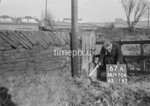 SD970467A, Man marking Ordnance Survey minor control revision point with an arrow in 1950s