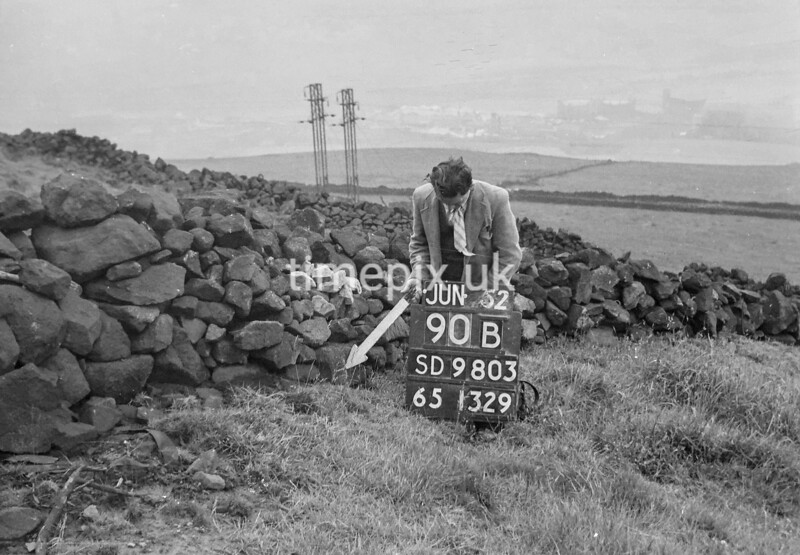 SD980390B, Man marking Ordnance Survey minor control revision point with an arrow in 1950s