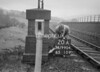 SD990420A, Man marking Ordnance Survey minor control revision point with an arrow in 1950s