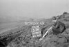 SD980353A2, Man marking Ordnance Survey minor control revision point with an arrow in 1950s
