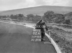 SD950302A, Man marking Ordnance Survey minor control revision point with an arrow in 1950s